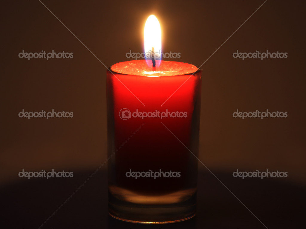 The red candle burning in full darkness  Stock Photo #1345591