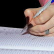 Female hand writing with pencil on sch — Stock Photo