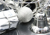 Silver gift, ball and bell - composition — Stock Photo