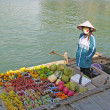 Stock Photo: Sellers of fruit