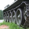 Stock Photo: Heavy tank track close-up of wheels