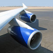 Wing of the jet plane - Stock Photo