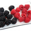 Blackberry and raspberry on a plate — Stock Photo