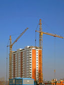 Cranes and building construction — Stock Photo