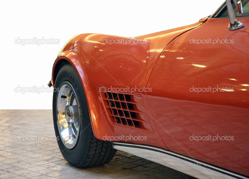 Side of red sporting car of the last century — Stock Photo #1392347