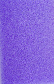 Textured violet sponge — Stock Photo