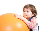 Little girl playing with ball — Stock Photo