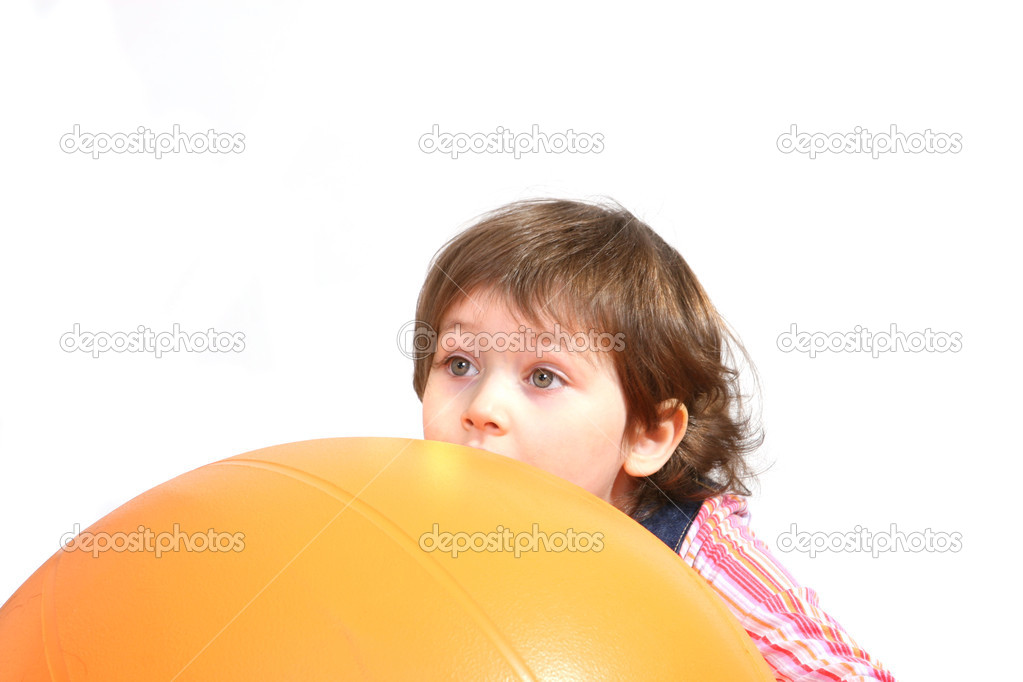 Little girl playing with big orange ball on white ground — Stock Photo #1776248