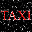 TAXI inscription at the night - Stock Photo