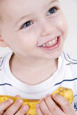 Close up of smiling boy with banana — Stock Photo