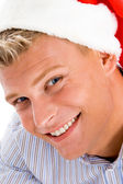 Happy man with christmas hat — Stock Photo