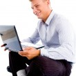 Smiling male with laptop — Stock Photo #1346770