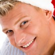 Happy man with christmas hat — Stock Photo #1346775