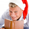 Pleased man with book and christmas hat — Stock Photo #1346782