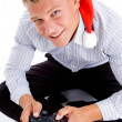 Stock Photo: Christmas boy playing video games