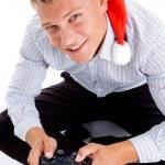 Christmas boy playing video games — Stock Photo