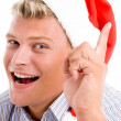 Man pointing up with christmas hat — Stock Photo #1346799