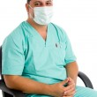 Surgeon with face mask sitting on chair — Stock Photo #1346907