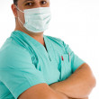 Male doctor posing with face mask — Stock Photo #1346913