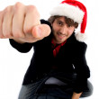Male with christmas hat showing punch — Stock Photo #1347042