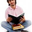 Young student busy with his books — Stock Photo
