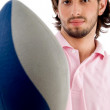 Stock Photo: Young man with rugby ball