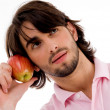 Royalty-Free Stock Photo: Male thinking and holding an apple