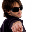 Male looking and pointing backwards — Stock Photo