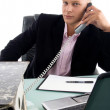 Businessman busy on phone — Stock Photo