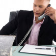 Executive busy on phone — Stock Photo #1347220