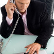 Handsome guy working in office — Stock Photo