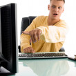 Man pointing on computer screen — Stock Photo #1347295