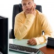 Handsome guy in thinking pose — Stock Photo