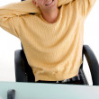 Man laughing while resting - Stock Photo