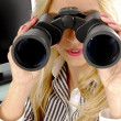 Female looking through binoculars - Stock Photo