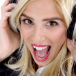 Royalty-Free Stock Photo: Shouting woman enjoying music