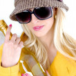 Fashionable woman holding wine bottle — Stock Photo