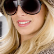 Smiling model wearing sunglasses - Stock Photo
