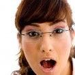 Shocked young female looking at camera — Stock Photo