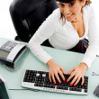 Businesswoman working on computer — Stock Photo