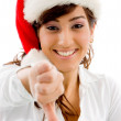 Christmas female with thumbs down — Stock Photo