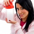 Smiling female holding water bottle - Stock Photo