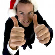 Businessman cheering with santa cap — Stock Photo