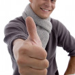 Smiling young man showing thumbs up — Stock Photo