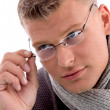Stock Photo: Young mholding eye wear