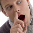 Man putting finger in his nose — Stock Photo