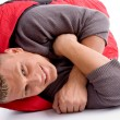 Handsome man in sleeping bag — Stock Photo