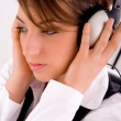 Stock Photo: Young female tuned in music