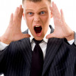 Stressed young businessman shouting — Stock Photo