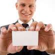 Smiling executive holding business card — Stock Photo #1349581